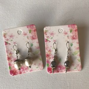 Two pair of pearl/metal earrings by Capture